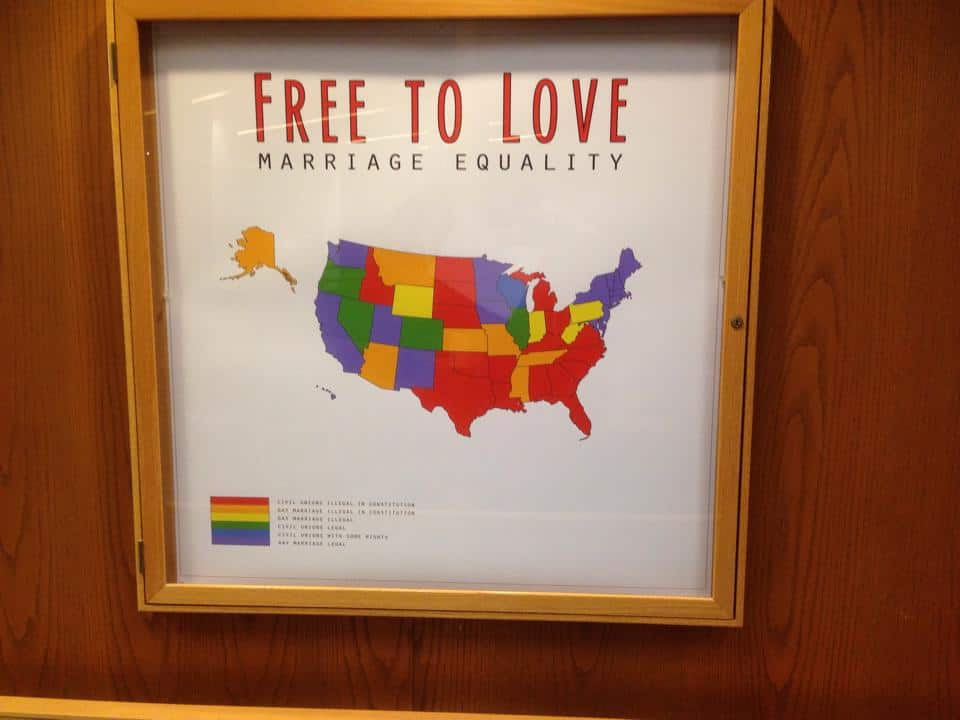 Marriage equality poster is proudly displayed on a wall in the Denison library.