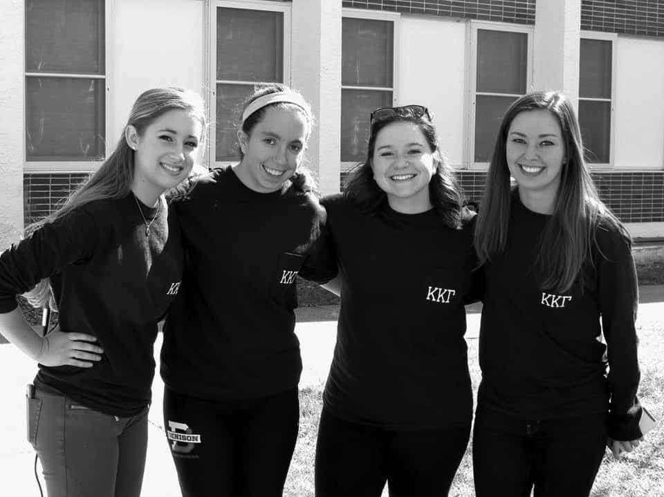 Emma Lynch '16, Laura Van Horn '16, Jessica Braid '16 and Molly McDonough '16 take a break from refereeing the games.
