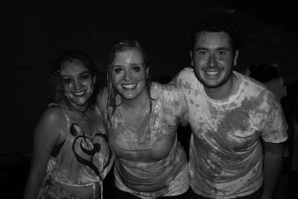 Kariana Santos '16, Mackenzie Byrd '16 and Jed Dioguardi '18 pose after being drenched in paint.