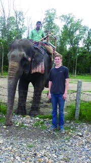 Schmidt poses with an elephant.